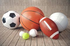 3d rendering sport balls on wooden backgorund. Set of sport balls. Sport equipment such us football, basketball. Baseball, tennis, golf ball for team and Royalty Free Stock Photo