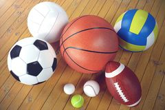 3d rendering sport balls on wooden backgorund. Set of sport balls. Sport equipment such us football, basketball. Baseball, tennis, golf ball for team and Royalty Free Stock Images