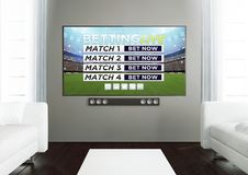 Wooden living room with live betting app at smart tv. 3d rendering of sports live betting app on smart tv on a wooden living room Stock Photo