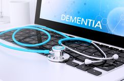 Stethoscope on laptop keyboard with screen showing dementia. 3d rendering of stethoscope on a laptop keyboard with screen showing dementia Royalty Free Stock Photo