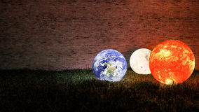 3d rendering of Sun, Moon and Earth place on grasses field Royalty Free Stock Images