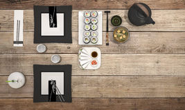 3d rendering sushi plate with black bowl soup on dining table. 3d design and rendering  by 3dsmax Royalty Free Stock Photo