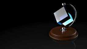 3D rendering. Table gift cube. Creative gift cube, made of transparent coloured stone on a wooden stand. Semicircular holder of shiny metal. Illustration of Stock Photography