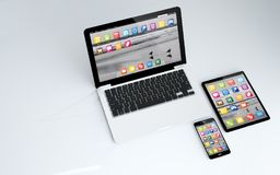 Tablet, laptop and smartphone. 3d rendering of tablet, laptop and smartphone. All screen graphics are made up Stock Photography