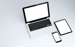 Tablet, laptop and smartphone white screen. 3d rendering of tablet, laptop and smartphone. white screen Royalty Free Stock Photos