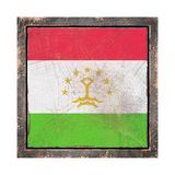Old Tajikistan flag. 3d rendering of a Tajikistan flag over a rusty metallic plate wit a rusty frame. Isolated on white background Royalty Free Stock Photo