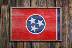 Wooden Tennessee flag. 3d rendering of a Tennessee State USA flag on a wooden frame and a wood wall Royalty Free Stock Photography