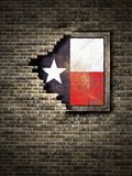Old Texas flag in brick wall. 3d rendering of a Texas State flag over a rusty metallic plate embedded on an old brick wall Royalty Free Stock Photos