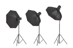 3d rendering of three large light with octoboxes stands turned down in several angles. Stock Photography