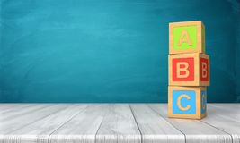 3d rendering of a three toy blocks standing on a wooden desk in one tower with letters A, B and C on them. Primary school. Basic skills. Reading and writing Royalty Free Stock Photo