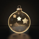3D rendering transparent Christmas ball. S on a dark background with stars inside Stock Photos
