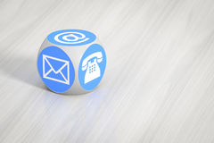 Turquoise cube with signs for email phone and letter. 3d rendering of a turquoise cube with signs for email phone and letter Stock Images