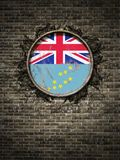 Old Tuvalu flag in brick wall. 3d rendering of a Tuvalu national flag over a rusty metallic plate embedded on an old brick wall Royalty Free Stock Photography