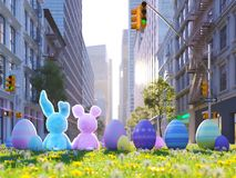 Two rabbits sitting in lawn with easter eggs infront of big city. 3d rendering. 3d rendering. two easter rabbits sitting in lawn with easter eggs Stock Photo