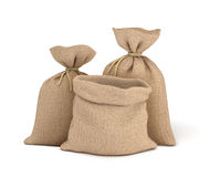 3d rendering of two tied canvas sacks and open sack in front view isolated on white background. Buying in bulk. Dry goods. Cargo and delivery royalty free illustration