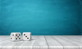 3d rendering of two white dice on a wooden desk on a blue background. High stakes. Casino and gambling. Grab your luck Stock Photo