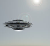 3D rendering UFO.The spacecraft against the sky . 3D rendering .The spacecraft against the sky Royalty Free Stock Photo