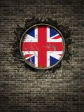 Old united kingdom flag in brick wall. 3d rendering of a united kingdom flag over a rusty metallic plate embedded on an old brick wall Stock Photos