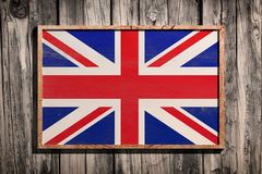 Wooden United Kingdom flag. 3d rendering of United Kingdom flag on a wooden frame over a planks wall Stock Photo