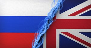 United Kingdom Vs Russia Flag Concept Cloth Texture Stock Photography