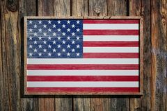 Wooden United States of America flag. 3d rendering of United States of America flag on a wooden frame over a planks wall Stock Images