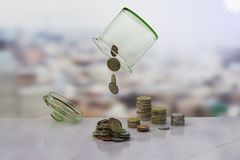 Upside down the jar of coins on the wooden backgro. 3D rendering, Upside down the jar of coins on the wooden background, bankruptcy or loss concept Stock Photos