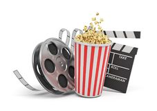 3d rendering of a video reel, popcorn bucket and a clapperboard on a white background. Cinema and movies. Watching films. Entertainment Royalty Free Stock Photo