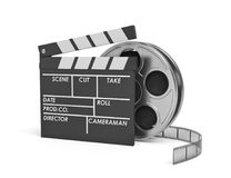 3d rendering of a video reel standing behind a black clapperboard with empty fields. Shooting new movies. Cameramen and directors. Cinema maker Royalty Free Stock Photos