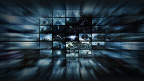 3d rendering. Video wall into space warp. A 3D illustration of a video wall. A large media image screen which shows many small monitors into a moving image to Stock Photos