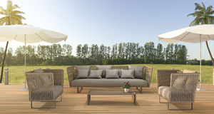 3d rendering vintage beach sofa on wood terrace near green field forest Royalty Free Stock Images