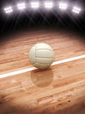 3d rendering of a Volleyball on a court with stadium lighting Stock Photo