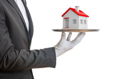 3d rendering waiter offering a house. On a tray Stock Photos