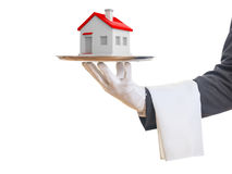 3d rendering waiter offering a house. On a tray Royalty Free Stock Images