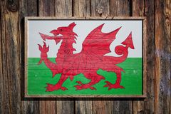 Wooden Wales flag. 3d rendering of a Wales flag on a wooden frame and a wood wall Royalty Free Stock Photography