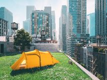 Wanderlust in a big city. camping concept. 3d rendering Stock Image