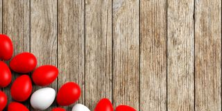 3d rendering white and red eggs on a wooden surface Royalty Free Stock Image
