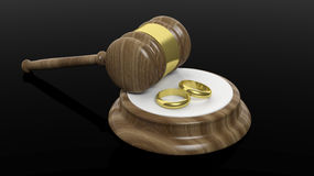 3D rendering of wooden gavel and two gold wedding bands Royalty Free Stock Image