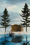 3d rendering of wooden log cabin behind frozen lake in the winte Stock Images