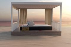 3d rendering of wooden patio with bed at sand beach in the eveni. Ng sunshine Stock Photo