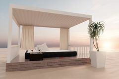 3d rendering of wooden patio with bed at sand beach in the eveni. Ng sunshine Stock Photography