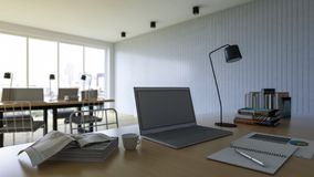 3d rendering of working table with depth of field photo. Working wooden table which have laptop, book,notebook,coffee cup and desk lamp on it, business concept Stock Images