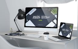 Workroom digital agency web design. 3d rendering of workroom with responsive devices showing digital agency on screen. All screen graphics are made up Royalty Free Stock Photography
