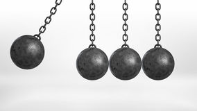 3d rendering of a wrecking ball swinging on white background beside three still hanging balls on white background. Royalty Free Stock Image
