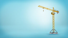 3d rendering of a yellow stationary tower crane without any load in full length on blue background. Building and construction. Workplace machinery. Heavy loads Stock Image