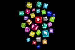 3D rendono il cubo dell'applicazione di Colorfull su un fondo di colore Immagine Stock Libera da Diritti