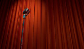 3d retro microphone on red curtain background. Low angle view Royalty Free Stock Images