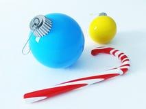 3D rinden de decoraciones coloridas hermosas de un día de fiesta con una caña de azúcar Fotos de archivo libres de regalías