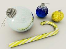 3D rinden de las chucherías de la decoración del día de fiesta del azul y del oro con el bastón de caramelo de cristal Fotos de archivo libres de regalías