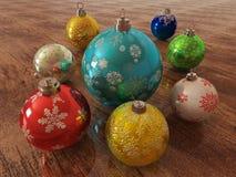 3D rinden de las chucherías multicoloras de la decoración del día de fiesta en superficie de madera Imágenes de archivo libres de regalías