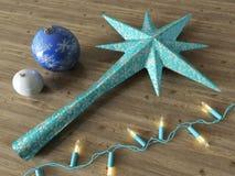 3d rinden de una decoración de la estrella azul y de la Navidad de las chucherías con las luces azules Foto de archivo